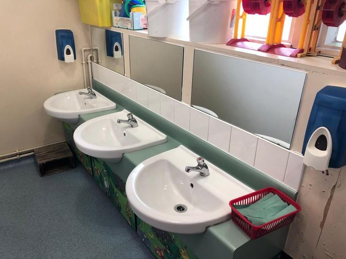 The sinks and handwashing area