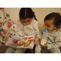 reading to her little brother :)