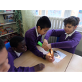 Science - Experimenting with light and reflection.