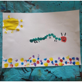 Iyla fingerpainting caterpillar.jpeg