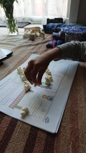 Ubaydah using popcorn to do his maths! 1SM