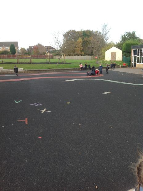 We paly on the balck part of the big playground.