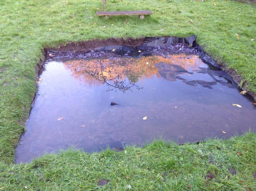 A slightly flooded fire pit area