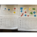 Jumana's practising her spellings & sorting shapes