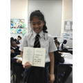 A really happy pupil who now owns her own autographed book!