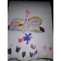Maria drew a colourful butterfly that makes her feel happy