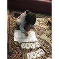 Working hard on her spellings