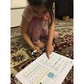 Practicing her addition skills