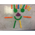Ali K creatively used 2d shapes to make a 'happy' man