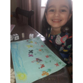 Using her colour and shape dice to make a picture