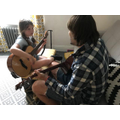 Learning a new song on the guitar