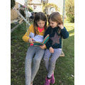 Fleur reading to her sister