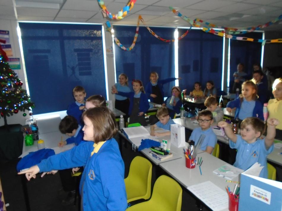 Hazel Class having an 'in seat' dance to our virtual pantomime.