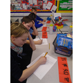 Practising writing the symbols.