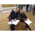 Examining artwork in the Long Gallery.