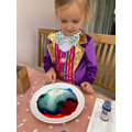 Heidi enjoyed dressing up and colour mixing.