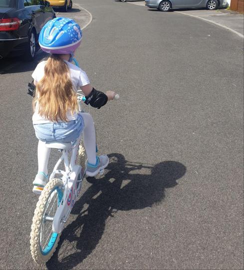 Evie riding her bike!