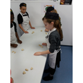 Making our bread rolls.