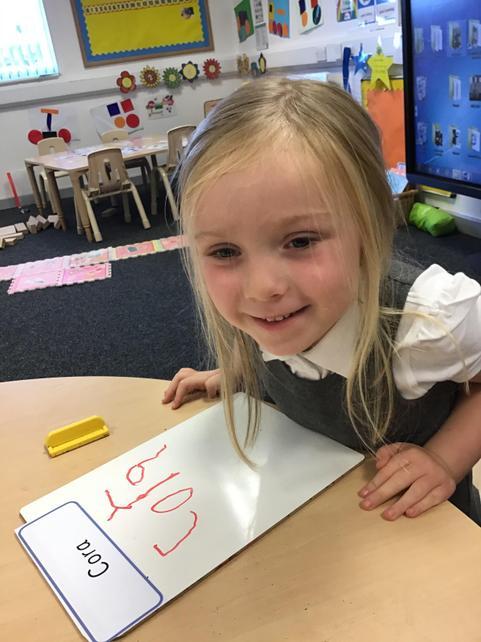 Cora wrote her name!