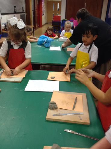 We used slip to help the clay stick.
