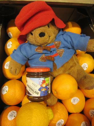 Paddington dived into a box of oranges!