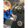Using natural materials to make our letters.