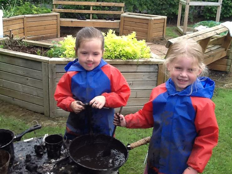 Getting messy in the mud kitchen