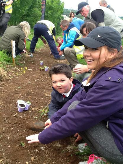 Ashton and his mum plant a plug