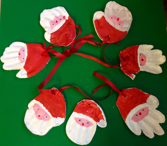 Look out! These handprint Santas are watching out for good behaviour at this time of year!