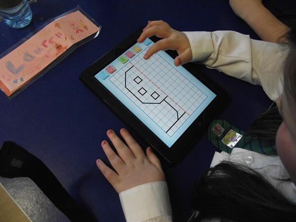 Year 4 children incorporating ipads into maths