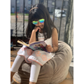Innaya reading on her Balcony