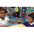 We compared our hands with each other.