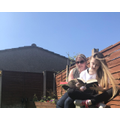Mrs Hindle reading in the sun with Maddie