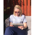 Mrs Hart reading in the sun