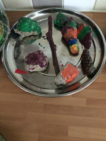 Harvey painted stones to brighten up his garden.