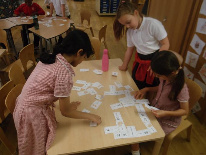 Working together to match the dominoes