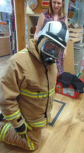 Fire Fighter Peter showed us how Fire Fighters have special equipment to keep them safe.