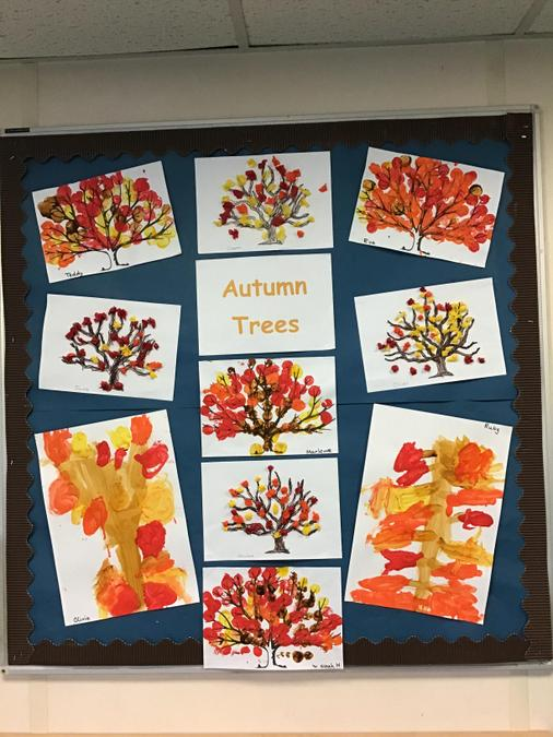 The children have used different media and techniques to create Autumn trees.