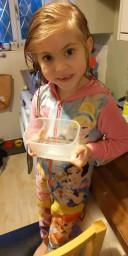 Lily finding which container holds the most water the