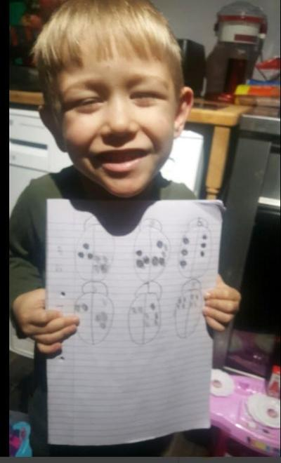 Dylan showing different ways of representing numbers