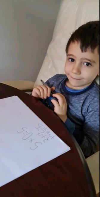 Omar writing number sentences
