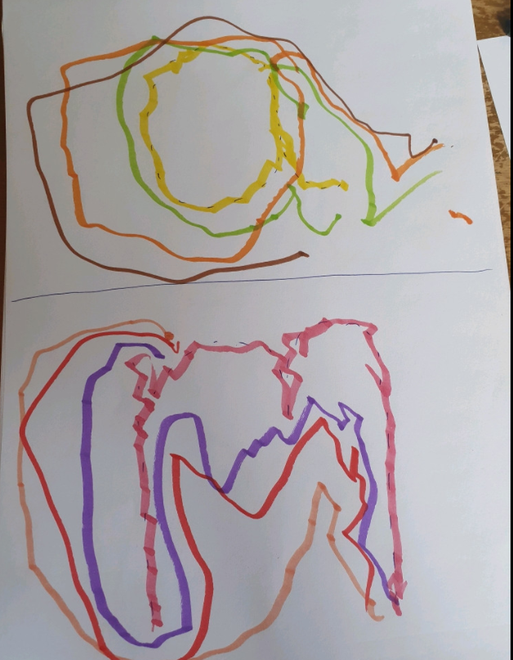 Lupin practising writing rainbow letters