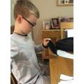 Harley using his sewing skills.