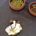 Grinding olives to make the oil.