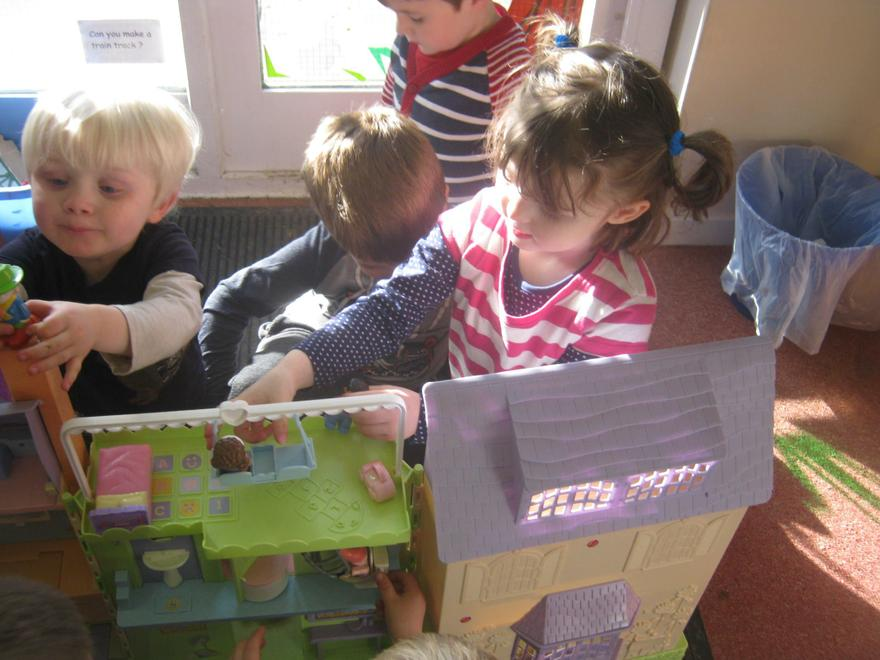 Playing with the dolls house