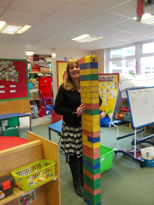 Mrs.Jameson is as tall as 28 bricks.