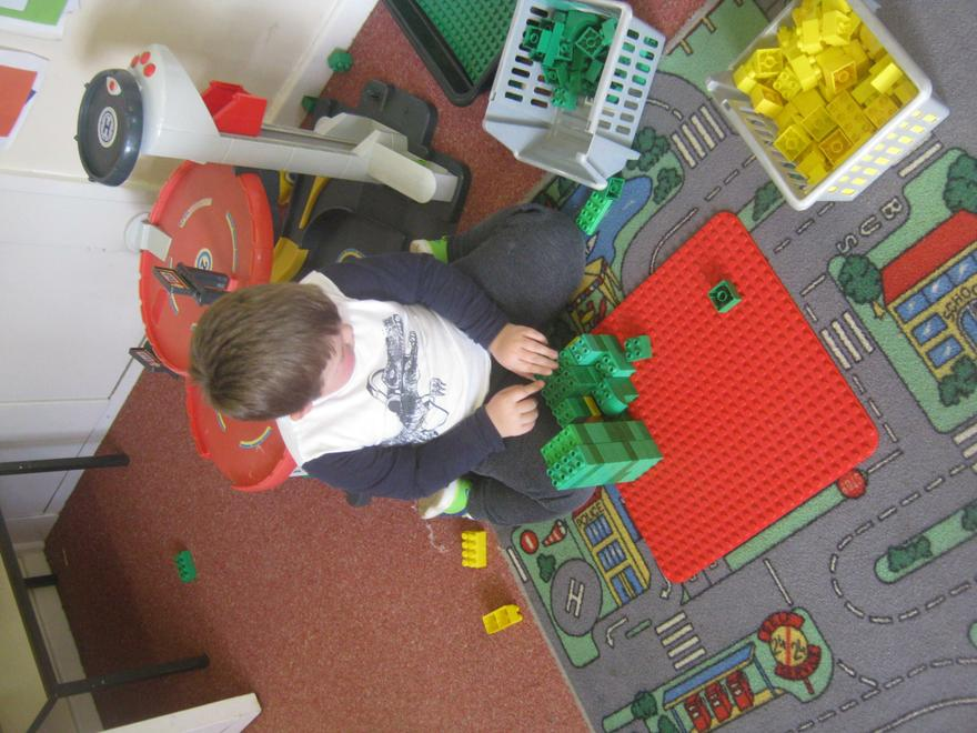 O.M building his house