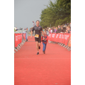 Hugo running down the red carpet with me to the finish line at the Outlaw Ironman Triathlon, 2018.