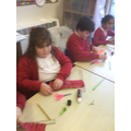 Creating flowers to decorate our class and corridor.