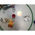 Sorting items that reflects light